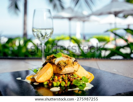 Fried fish with potatoes and salad on a white plate. Rrestoran - stock photo