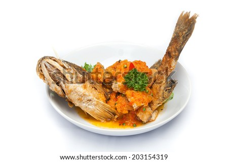 Fried fish with sauce - stock photo