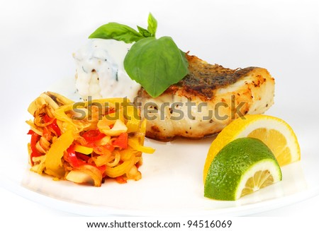 fried fish with sauce and vegetables, table setting, background for menu
