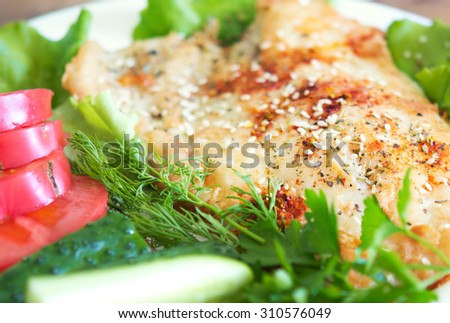 fried fish with spices and vegetables - stock photo