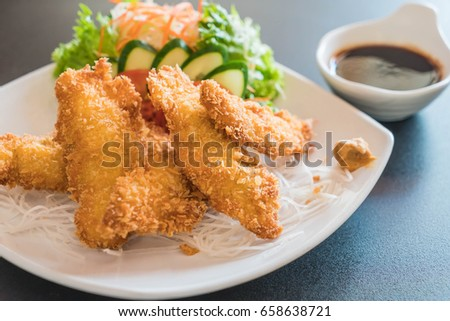 fried fish with tonkatsu sauce - japanese food style