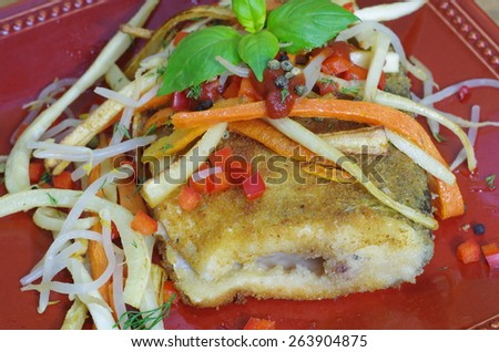 fried fish with vegetable  on plate - stock photo