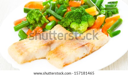 fried fish with vegetables - stock photo