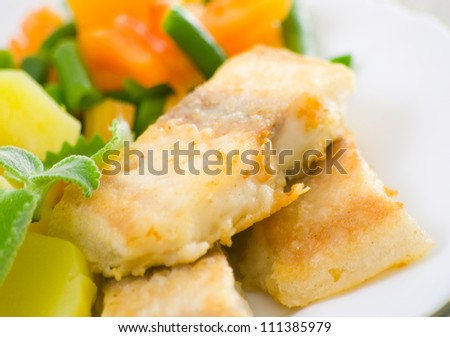 fried fish with vegetables and potato