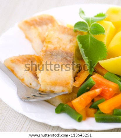 fried fish with vegetables and potato - stock photo
