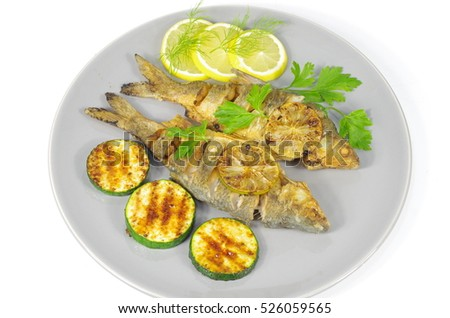 fried fish with vegetables on  plate