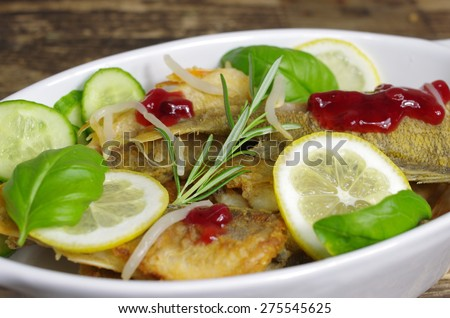 fried fishes with basil  on white plate - stock photo
