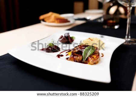 Fried foie gras with cherry sauce and figs - stock photo
