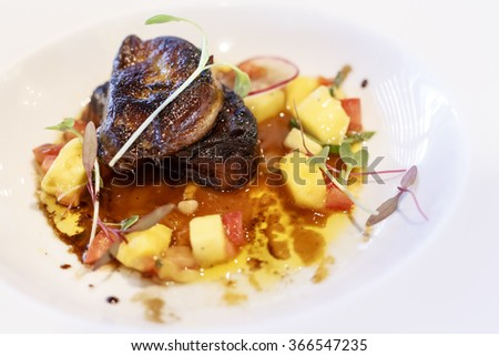 Fried foie gras with mango sauce and figs