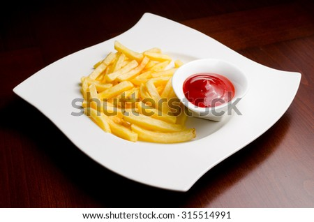 fried French fries with ketchup - stock photo