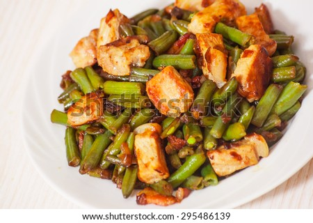 fried green beans with meat - stock photo