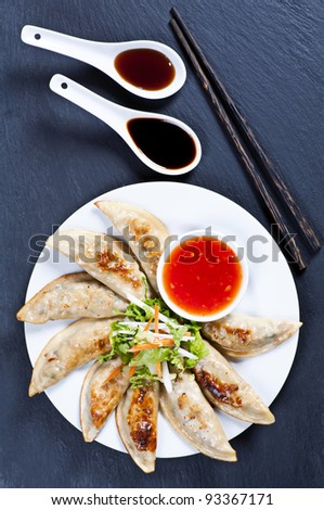 Fried guotie with chili and soy sauce - stock photo
