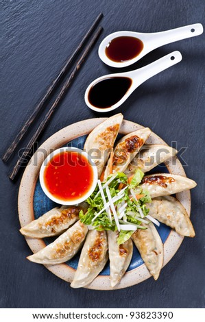 Fried Guotie with dipping sauces - stock photo