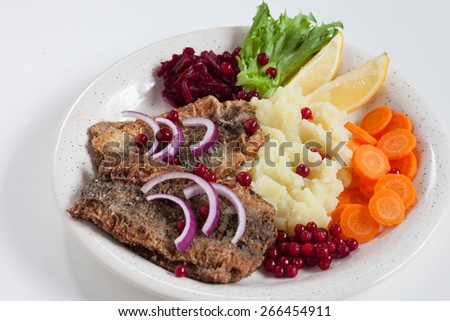Fried herring with mashed potatoes, Finish and Swedish traditional food, selective focus, top view - stock photo