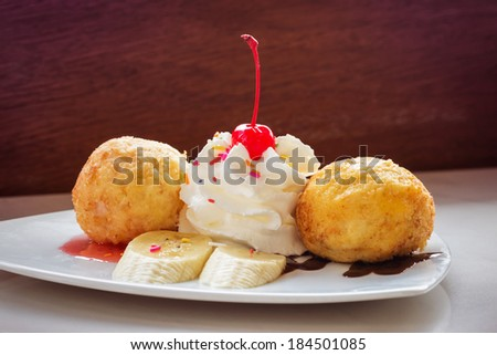 Fried ice-cream and whipped cream - stock photo