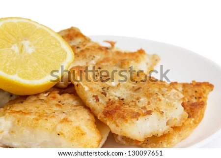 fried in flour codfish on plate, isolated on white background - stock photo