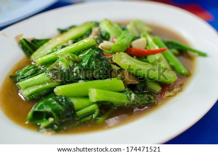 Fried kale and vegetables in oyster sauce - stock photo