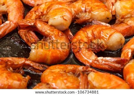 Fried King Prawns in a Frying Pan, closeup - stock photo