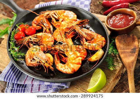 Fried king prawns on iron pan - stock photo