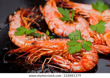 Fried king shrimps with lemon - stock photo