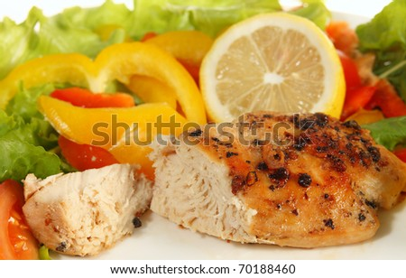 Fried lemon pepper chicken breast steak with a salad - stock photo