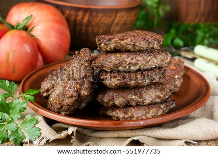 Fried liver pancakes or cutlets in rustic style