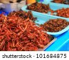 Fried locust in asia street market. - stock photo