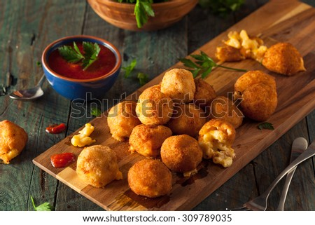 Fried Mac and Cheese Bites with Dipping Sauce - stock photo