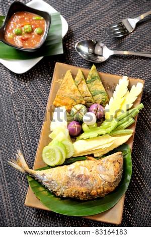 Fried Mackerel fish,chili sauce ,and fried vegetable - stock photo