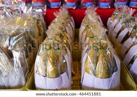 Fried mackerel fish packed in plastic bag, ready to sell