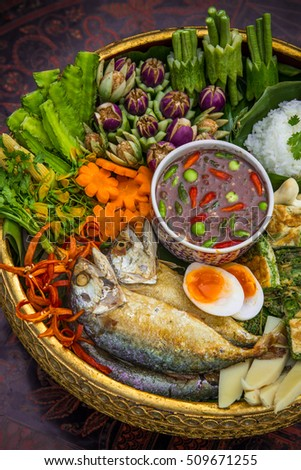 Fried mackerel with chili shrimp paste sauce and vegetable set. Thai food.