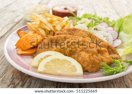 Fried Meat cutlets with salad and potato chips