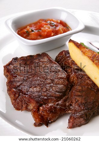 Fried meat with sauce on white plated