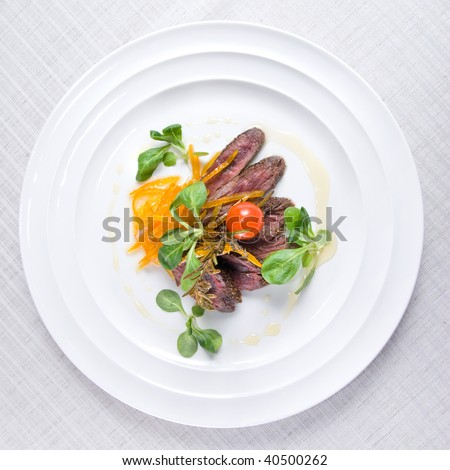 fried meat with vegetables on the plate isolated on white - stock photo