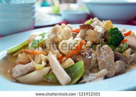 fried mix vegetable and shrimp in Dishes on table
