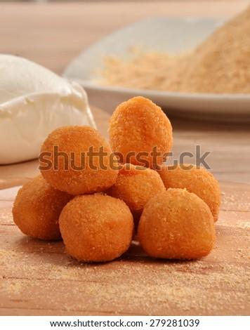 Fried mozzarella stick balls and ingredients. - stock photo