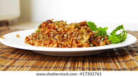 Fried mushrooms agaric on a plate. Vegetarian food - stock photo
