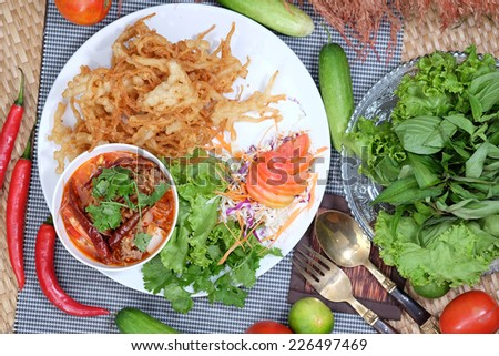 Fried mushrooms and spicy salad. - stock photo