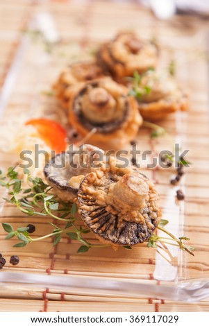 Fried mushrooms with fresh thyme - stock photo