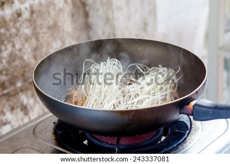 fried noodle in pan for thai food menu - stock photo