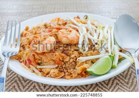 fried noodles thai style with prawns (pad thai), stir-fried thai noodles - stock photo