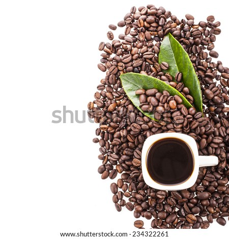 fried not ground coffee beans and white cup with a coffee drink and green leaves  Isolated on white background - stock photo