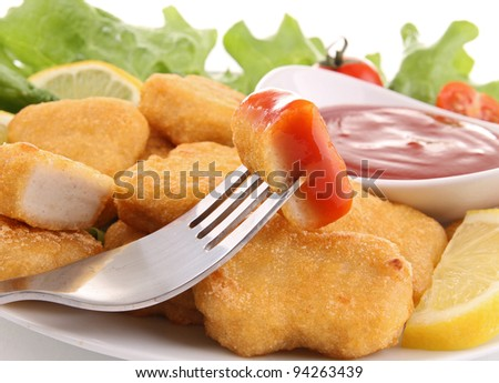 fried nuggets with ketchup - stock photo