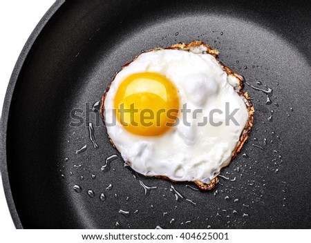 Fried one egg in a frying pan  - stock photo