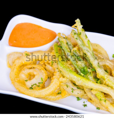 fried onion rings snack on white plate - stock photo