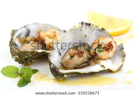 fried oysters and prawns in a shell isolated on white - stock photo