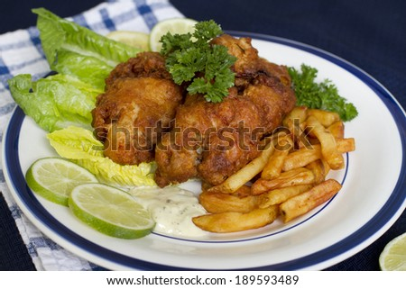 Fried oysters with chips, lime and souse