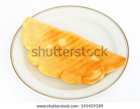 Fried patty on  platter. - stock photo