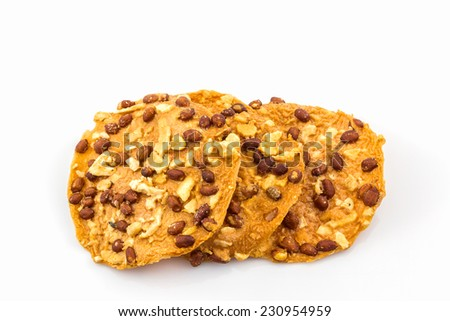 Fried peanut candy on white background, Thai dessert. - stock photo