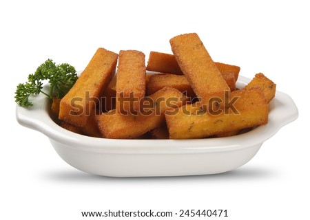 Fried polenta on white background - stock photo